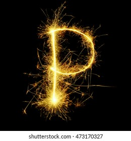 English alphabet and number from yellow sparkler on black background
