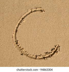 English alphabet in the sand