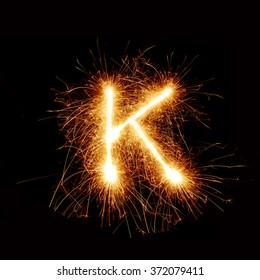 English alphabet from Sparkler firework on black background
