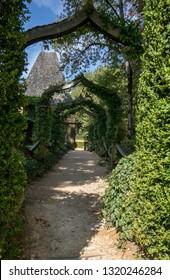 English arcade in the picturesque Jardins du Manoir d Eyrignac in Dordogne. France