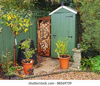 English back garden in Autumn with shed and log store