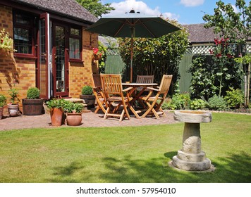 English back Garden Patio with table, chairs and parasol and Bird-Bath