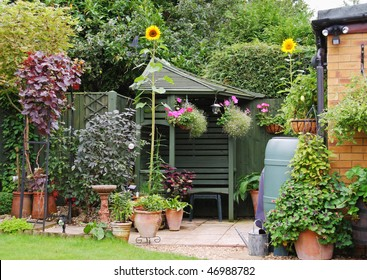 An English Back garden scene with Potted Plants and Gazebo