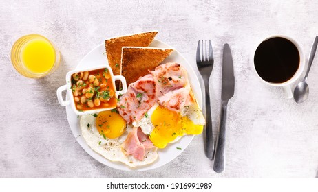 english breakfast with egg, bacon and coffee cup