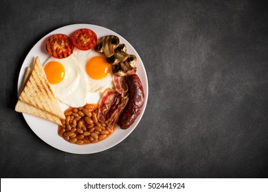 English breakfast on a black chalkboard, copy space for text