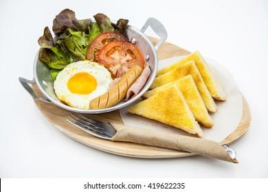 English breakfast - toast, egg, ham and vegetables on white background