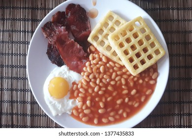 English breakfast. Traditional food on white plate.