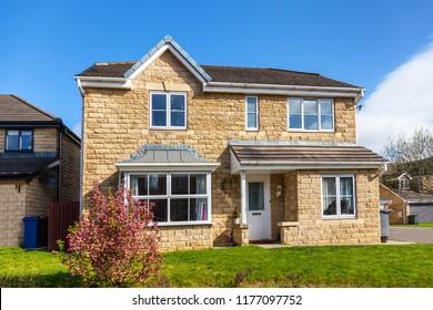 English brick house with garden