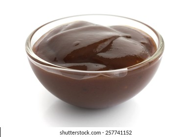 English brown sauce in small glass dish.
