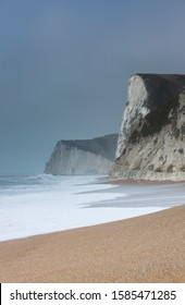 English channel coast, England, UK- February 2019: Climate change links to severe winter gales and dangerous surf conditions at tourist beaches, with undertows, and increased coastal erosion.