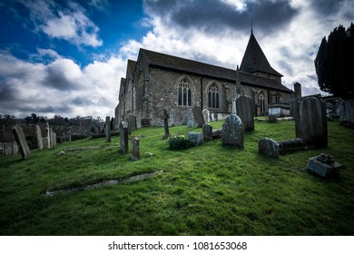 English church and graveyard in dramatic light