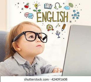 English concept with toddler girl using her laptop