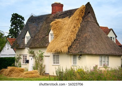 English Cottage being thatched with new thatch