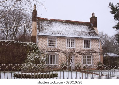 English Country Cottage in the Winter Snow