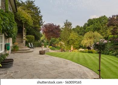 English country garden in the Peak District, Derbyshire, UK - Shutterstock ID 563059165