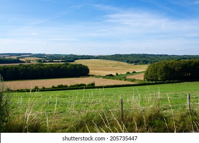 English Countryside. Typical view of the English landscape on a summers evening. Mixed land use woods and farming.