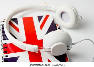 english courses logo concept with british flag and headphones. English school logotype