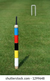 An English croquet lawn, focus on the centre peg