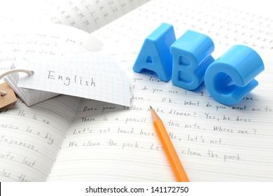 English education, alphabet toy on notebook