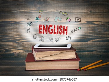 English, education and business background. Concept cloud coming from screen of the phone, books on the desk