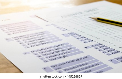 english exercise and answer sheet on table represent testing english grammar with gradient light