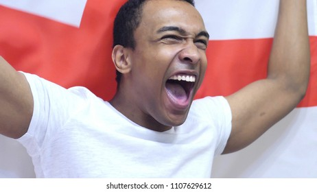 English Fan Celebrating while holding the Flag of England in Slow Motion
