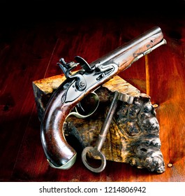 English flintlock pistol and jailers key made in the early 1800's with room for your type.