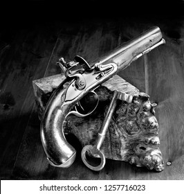 English flintlock pistol and jailers key made in the early 1800's in black and white.