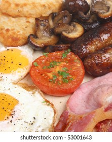 English fried breakfast with hash browns and mushrooms