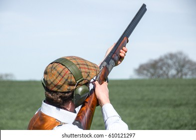 English gentleman with shotgun
