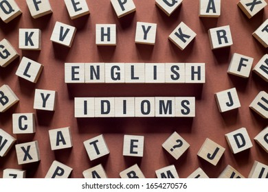English idioms word concept on cubes