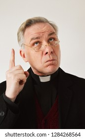 English/ Irish Vicar, Priest pointing