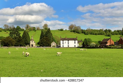 An English Landscape in the Derby Dales with village and grazing sheep