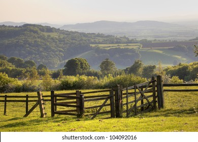 English landscape with gate at sunset