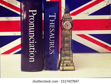 English language thesaurus and pronunciation dictionary near a tacky Big Ben reproduction on a grunge Union Jack background