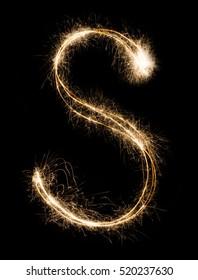 English Letter S made from burning sparkles on black background. Shiny festive firework font, latin alphabet text sign.