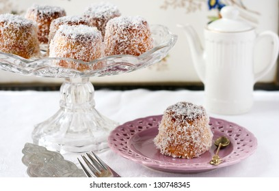 English madeleines on the cake dish and plate