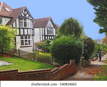 English middle class suburban street with Tudor style houses