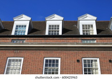 English modern brick building with a lovely blue sky sunny day background, Spring time of England UK.