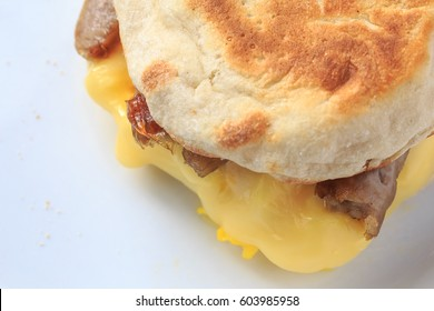 English muffin, sausage, egg and cheese breakfast sandwich.