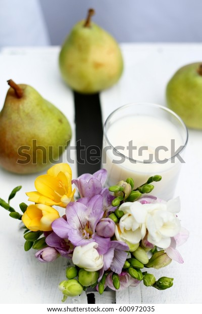English pear and freesia, spring scented candle on a wooden painted vintage crate, wedding table decoration , shallow depth of field