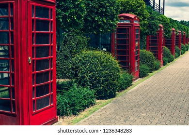 English phone booths in the national park of thailand (cross process)