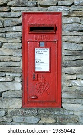 English post box in a Cotswold stone wall