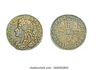 An English pre-decimal sixpence dated 1686 with the bust of King James II on the obverse and isolated on a white background.