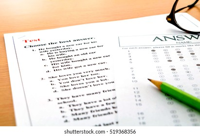 english questions and answer sheet on table