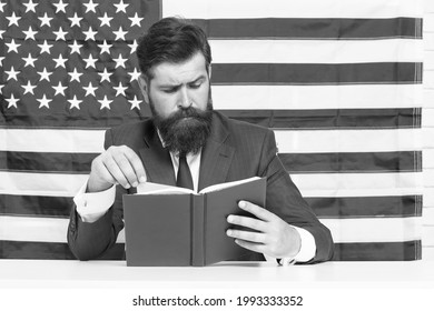 English reading. American bibliophile. Bearded man read book on USA flag background. Reading and comprehension. Home reading. Self-study lesson. School and education. Improve your reading skills