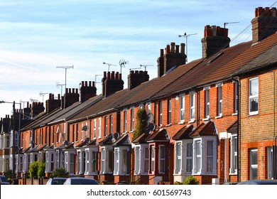 English row terraced house in spring season, England UK. Brick building and environment.