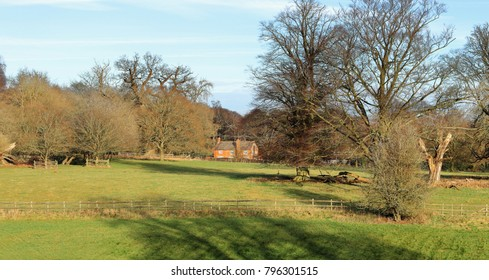 An English Rural Landscape in the Chiltern Hills with Traditional red brick Cottage