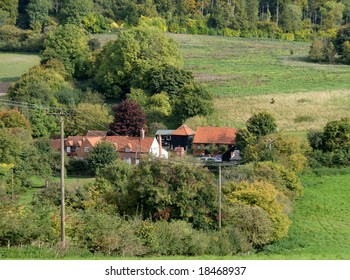 English Rural Landscape in early Autumn with farmhouse in the Valley