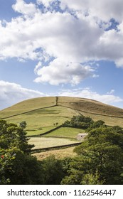 English rural scene of fields separated by dry stone walls on a hill in Edale Valley, Derbyshire, UK